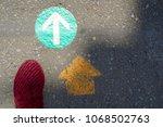 a foot and double arrowhead go... | Shutterstock . vector #1068502763