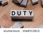 Small photo of DUTY Word Written In Wooden Cube