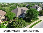 perfectly manicured lawns and... | Shutterstock . vector #1068521987