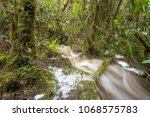 floodwater pouring through the... | Shutterstock . vector #1068575783