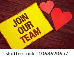 Small photo of Conceptual hand writing showing Join Our Team. Business photo text Get over unemployment joining better career workforce written Yellow Sticky note paper wooden background Hearts.