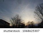 sunset middle class neighborhood | Shutterstock . vector #1068625307