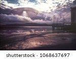 3d illustration. ufo arriving...   Shutterstock . vector #1068637697