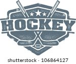 adult,badge,crest,distressed,grunge,high school,hockey,hockey puck,hockey stick,icon,rubber stamp,sports,vector,vintage,youth