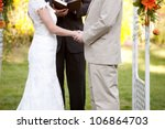 couple getting married at an... | Shutterstock . vector #106864703