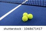 tennis balls on an indoor... | Shutterstock . vector #1068671417