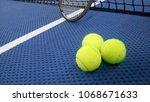 tennis balls on an indoor... | Shutterstock . vector #1068671633