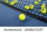 tennis balls on an indoor... | Shutterstock . vector #1068672257