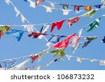 Multicolored shirts hanging - stock photo