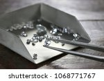 brilliant cut diamond held by... | Shutterstock . vector #1068771767