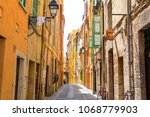 narrow street with colorful...   Shutterstock . vector #1068779903