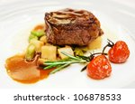 Tenderloin steak in plate, close-up - stock photo