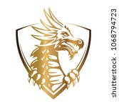 gold vector head of a dragon in ... | Shutterstock .eps vector #1068794723