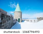 the old quebec city wall at... | Shutterstock . vector #1068796493
