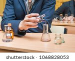 students experimenting and... | Shutterstock . vector #1068828053