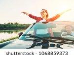 happy couple in love go by... | Shutterstock . vector #1068859373