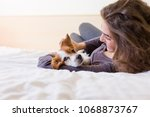 beautiful young woman lying on... | Shutterstock . vector #1068873767