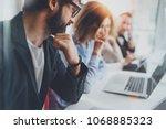 teamwork process concept.happy... | Shutterstock . vector #1068885323