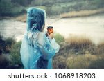 a lonely girl in a raincoat... | Shutterstock . vector #1068918203