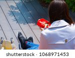 woman female eat lunch in her... | Shutterstock . vector #1068971453