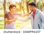 two sportsmen shake hands to... | Shutterstock . vector #1068996107