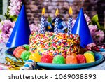 birthday cake with rainbow... | Shutterstock . vector #1069038893