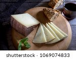 cured cheese on board | Shutterstock . vector #1069074833