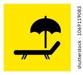 sun lounger with umbrella icon... | Shutterstock .eps vector #1069119083