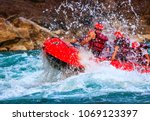 young person rafting on the... | Shutterstock . vector #1069123397