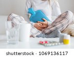 woman with hot water bottle... | Shutterstock . vector #1069136117