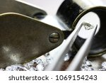 brilliant cut diamond held by... | Shutterstock . vector #1069154243