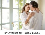 mature couple hugging in a... | Shutterstock . vector #106916663