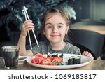 little cute little girl eating... | Shutterstock . vector #1069183817
