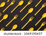 many yellow plasic forks and... | Shutterstock . vector #1069190657