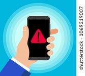 hand holding black mobile phone ... | Shutterstock .eps vector #1069219007