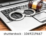 laptop with gavel and handcuffs ...   Shutterstock . vector #1069219667