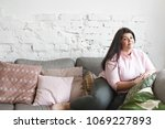 happy beautiful young plus size ... | Shutterstock . vector #1069227893