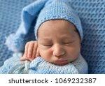 sleeping newborn baby   Shutterstock . vector #1069232387