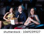 group of children sitting at... | Shutterstock . vector #1069239527