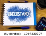 Small photo of Word writing text Understand Motivational Call. Business concept for Know Perceive the meaning of something written on Notepad on wooden background Pen Cup and Calculator next to it.