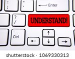 Small photo of Writing note showing Understand Motivational Call. Business photo showcasing Know Perceive the meaning of something written on Red Key Button on White Keyboard with copy space. Top view.