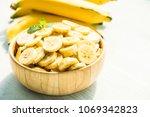 raw yellow banana fruit slices... | Shutterstock . vector #1069342823