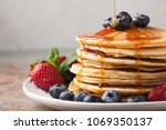 close up delicious pancakes ...   Shutterstock . vector #1069350137