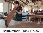 young woodworker wearing an...   Shutterstock . vector #1069475657
