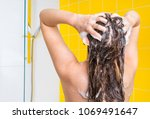 attractive woman washing her... | Shutterstock . vector #1069491647