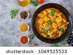 curry with chicken and onions.... | Shutterstock . vector #1069525523