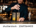 young barman in a blue shirt... | Shutterstock . vector #1069564403