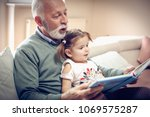 happy grandfather and...   Shutterstock . vector #1069575287