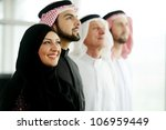 Successful and happy business arabic  people looking up,copyspace - stock photo