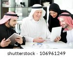 Business arabic people meeting indoor with electronic tablet - stock photo